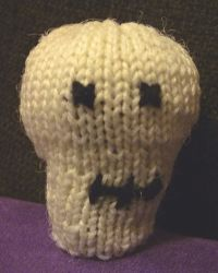 Skelly Baby, a hand-knitted toy skull